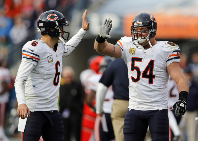 Chicago Bears quarterback Jay Cutler (6) celebrates with middle linebacker Brian Urlacher (54) after the Bears scored a touchdown against the Tennessee Titans in the fourth quarter of an NFL football game on Sunday, Nov. 4, 2012, in Nashville, Tenn. The Bears beat the Titans 51-20. (AP Photo/Joe Howell)