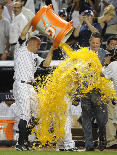 New York Yankees' Brett Gardner, left, douses Jayson Nix after Nix hit the game-winning RBI single to lift the Yankees to a 3-2 win over the Toronto Blue Jays in the second baseball game of a doubleheader at Yankee Stadium, Tuesday, Aug. 20, 2013, in New York. (AP Photo/Bill Kostroun)