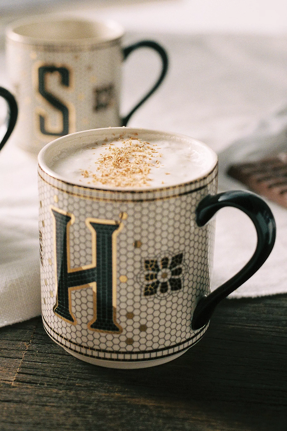 """<h3>Anthropologie Tiled Margot Monogram Mug</h3><br>Is it just us, or does coffee taste better out of a pretty mug with our very own initial emblazoned on the front? <br><br><em>Shop <strong><a href=""""https://www.anthropologie.com/"""" rel=""""nofollow noopener"""" target=""""_blank"""" data-ylk=""""slk:Anthropologie"""" class=""""link rapid-noclick-resp"""">Anthropologie</a></strong></em><br><br><strong>Anthropologie</strong> Tiled Margot Monogram Mug, $, available at <a href=""""https://go.skimresources.com/?id=30283X879131&url=https%3A%2F%2Fwww.anthropologie.com%2Fshop%2Ftiled-margot-monogram-mug"""" rel=""""nofollow noopener"""" target=""""_blank"""" data-ylk=""""slk:Anthropologie"""" class=""""link rapid-noclick-resp"""">Anthropologie</a>"""