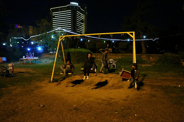 In this Feb. 13, 2019 photo, children play at a park in Baghdad, Iraq. For the first time in years, Iraq is not at war. The defeat of the Islamic State group in late 2017 after a ruinous four-year conflict has given the population a moment of respite, and across the capital Baghdad there is a guarded sense of hope. (AP Photo/Khalid Mohammed)
