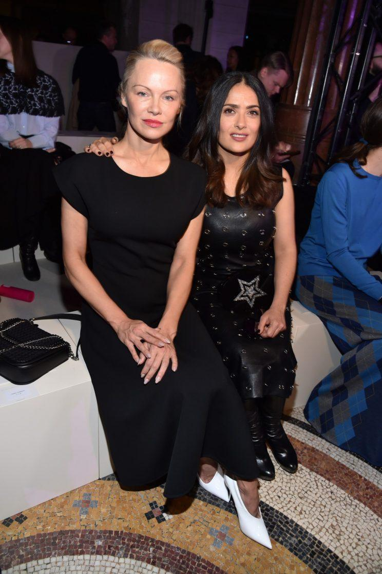 Pamela Anderson and Salma Hayek attend the Stella McCartney Fall/Winter 2017 show in Paris, France. (Photo: Getty)