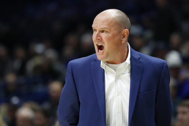 Lipscomb head coach Lennie Acuff directs his players from the bench during the first half of an NCAA college basketball game against Xavier, Saturday, Nov. 30, 2019, in Cincinnati. (AP Photo/John Minchillo)