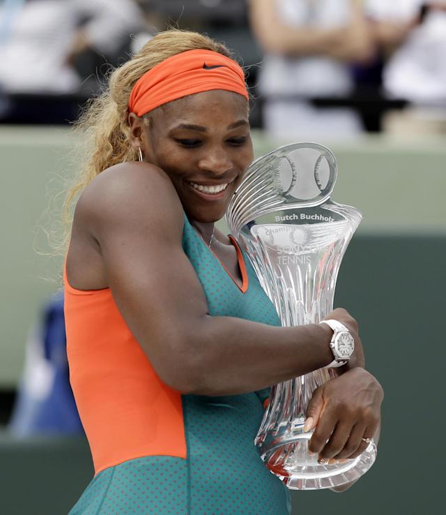 Serena Williams, of the United States, hugs the the trophy as she poses for photos after defeating Li Na, of China, in the women's final 7-5, 6-1 at the Sony Open Tennis tournament in Key Biscayne, Fla., Saturday, March 29, 2014. (AP Photo/Alan Diaz)