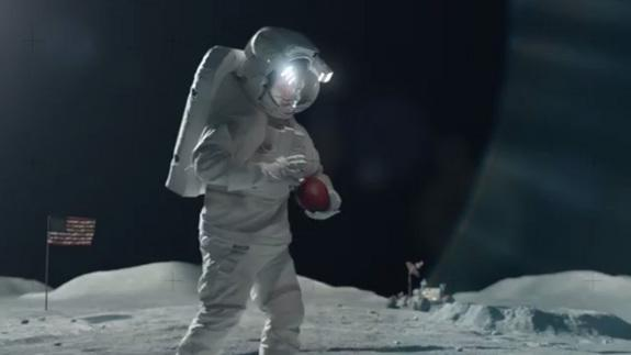 NFL star Tim Tebow plays football on the moon in a 30-second T-mobile ad for Super Bowl XLVIII.