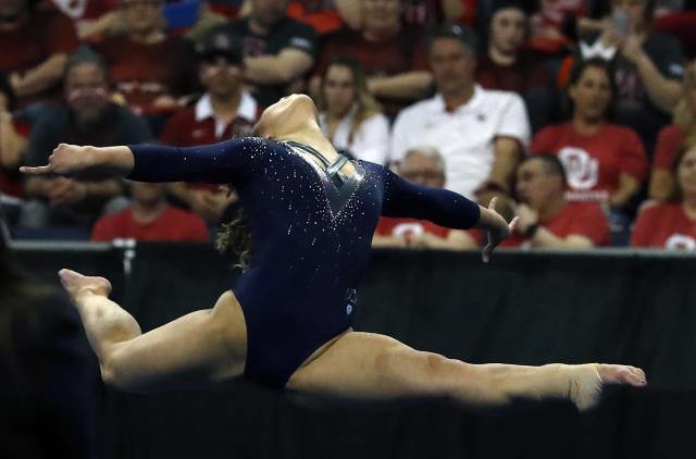 UCLA's Katelyn Ohashi competes in the floor exercise during the NCAA women's gymnastics championships Saturday, April 21, 2018, in St. Louis. (AP Photo/Jeff Roberson)