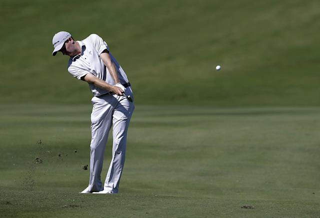 Brendon Todd hits off the fairway on his approach to the 18th green during the second round of the Byron Nelson Championship golf tournament, Friday, May 16, 2014, in Irving, Texas. Todd finished the round at 8-under par. (AP Photo/Tony Gutierrez)