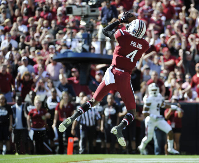 South Carolina wide receiver Shaq Roland (4) catches a pass for a touchdown against Mississippi State during the first half of an NCAA college football game, Saturday, Nov. 2, 2013, in Columbia, S.C. (AP Photo/Rainier Ehrhardt)