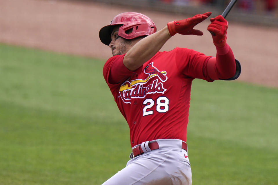 St. Louis Cardinals' Nolan Arenado (28) strikeout swinging during the third inning of a spring training baseball game against the Miami Marlins, Monday, March 22, 2021, in Jupiter, Fla. (AP Photo/Lynne Sladky)