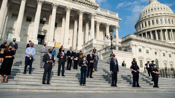 PHOTO: Speaker Nancy Pelosi, along with members and staff, observe a moment of silence on the House steps of the Capitol to honor victims of the September 11, 2001, terrorist attacks on Sept. 11, 2020. (Tom Williams/CQ Roll Call via Newscom)