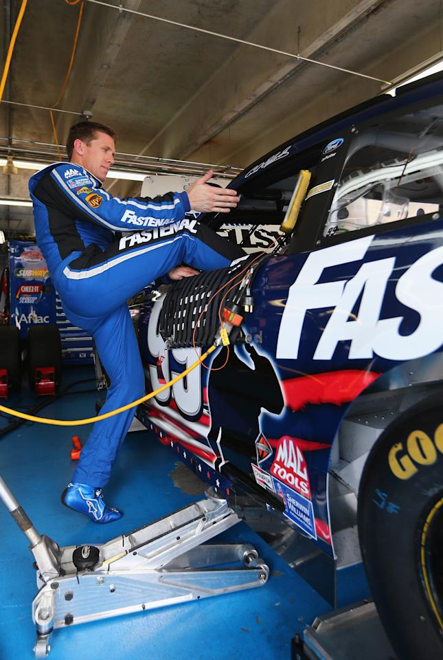 CONCORD, NC - MAY 23:  Carl Edwards, driver of the #99 Fastenal Ford, climbs in his car during practice for the NASCAR Sprint Cup Series Coca-Cola 600 at Charlotte Motor Speedway on May 23, 2013 in Concord, North Carolina.  (Photo by Streeter Lecka/Getty Images)