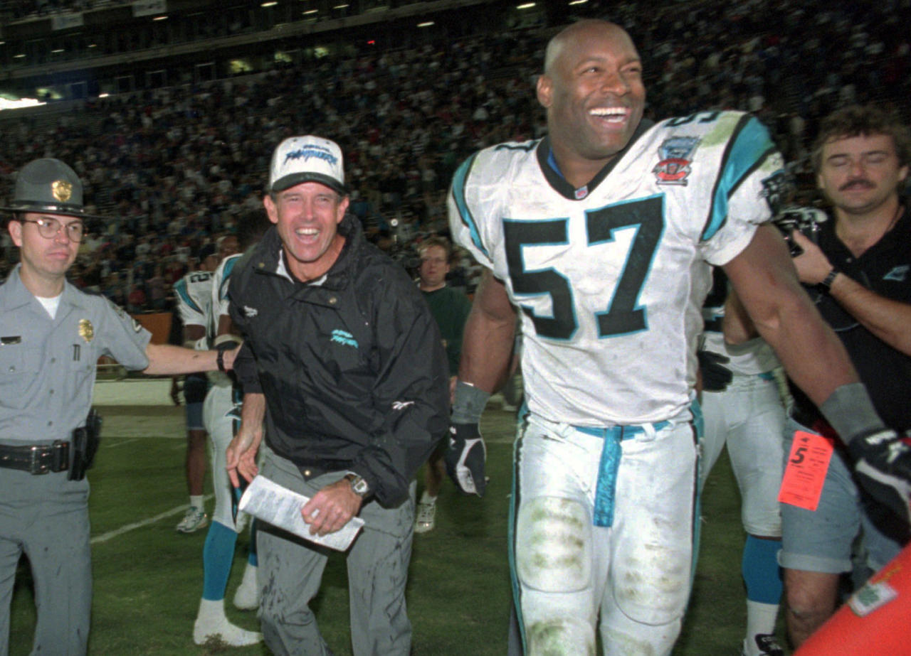 FILE - In this Oct. 15, 1995, file photo, Carolina Panthers head coach Dom Capers, center, and linebacker Lamar Lathon (57) celebrate the team's first win, 26-15 over the New York Jets at Memorial Stadium in Clemson, S.C. Carolina went 7-9 in their inaugural season in 1995 with Kerry Collins leading the way. The Panthers made it to the NFC championship game a season later, losing 30-13 to Brett Favre and the Green Bay Packers. (AP Photo/Alan Marler, File)