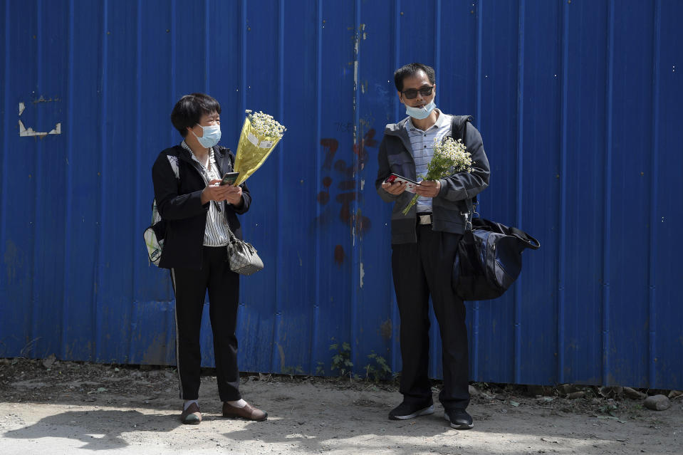 Wei Xiuwen, left, mother of Chen Mei, chats with Cai Jianli, father of Cai Wei outside a courthouse after attending their children's court cases in Beijing, Tuesday, May 11, 2021. Two amateur computer coders taken by police from their Beijing homes last year were standing trial Tuesday in a case that illustrates the Chinese government's growing online censorship and heightened sensitivity to any deviation from the official narrative on its COVID-19 response. (AP Photo/Andy Wong)