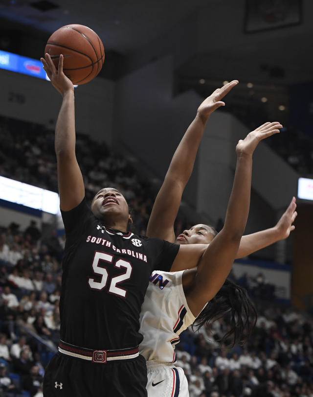 South Carolina's Tyasha Harris (52) goes up for a basket as Connecticut's Megan Walker (3) defends during the first half of an NCAA college basketball game, Monday, Feb. 11, 2019, in Hartford, Conn. (AP Photo/Jessica Hill)