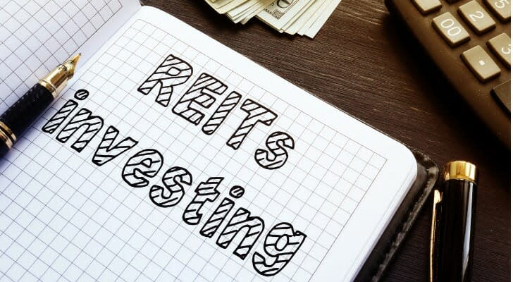 REITs Investing written in a notebook