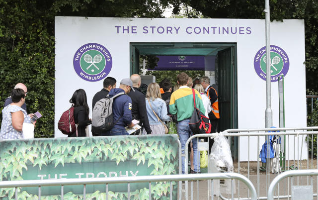 """In this Tuesday, July 9, 2019 tennis fans wait in line for tickets to enter the Wimbledon Tennis Championships in London. For many the Wimbledon experience starts in a tent as they gather in a small park across from the tournament grounds to camp out, some for days, in the hope of getting a ticket to Centre Court as they are released each day. """"The Queue"""" is a decades-old tradition that has grown to become its own phenomenon.(AP Photo/Natasha Livingstone)"""