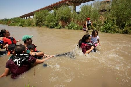 Migrants from Honduras cross the Rio Bravo river to enter illegally into the United States as seen from Ciudad Juarez
