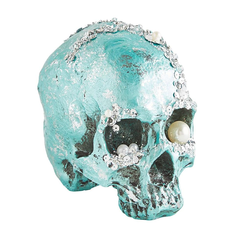 """<p>This <a href=""""https://www.popsugar.com/buy/Bejeweled-Turquoise-Halloween-Skull-479528?p_name=Bejeweled%20Turquoise%20Halloween%20Skull&retailer=pier1.com&pid=479528&price=18&evar1=casa%3Aus&evar9=46495717&evar98=https%3A%2F%2Fwww.popsugar.com%2Fphoto-gallery%2F46495717%2Fimage%2F46495720%2FBejeweled-Turquoise-Halloween-Skull&list1=halloween%2Cpier%201%2Challoween%20decor&prop13=api&pdata=1"""" rel=""""nofollow"""" data-shoppable-link=""""1"""" target=""""_blank"""" class=""""ga-track"""" data-ga-category=""""Related"""" data-ga-label=""""http://www.pier1.com/bejeweled-turquoise-halloween-skull/4117752.html"""" data-ga-action=""""In-Line Links"""">Bejeweled Turquoise Halloween Skull</a> ($18) comes in a pretty metallic color that makes it both fabulous and spooky. </p>"""