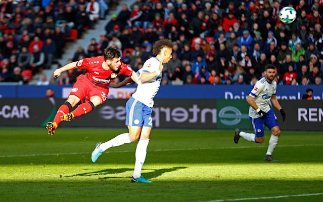 Soccer Football - Bundesliga - Bayer Leverkusen vs Schalke 04 - BayArena, Leverkusen, Germany - February 25, 2018 Bayer Leverkusen's Kevin Volland in action with Schalke's Thilo Kehrer REUTERS/Thilo Schmuelgen DFL RULES TO LIMIT THE ONLINE USAGE DURING MATCH TIME TO 15 PICTURES PER GAME. IMAGE SEQUENCES TO SIMULATE VIDEO IS NOT ALLOWED AT ANY TIME. FOR FURTHER QUERIES PLEASE CONTACT DFL DIRECTLY AT + 49 69 650050