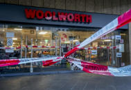 A crime scene tape is fixed in front of a Woolworth store in central Wuerzburg, Germany, Saturday, June 26, 2021. German police say several people have been killed and others injured in a knife attack in the southern city of Wuerzburg on Friday.(AP Photo/Michael Probst)