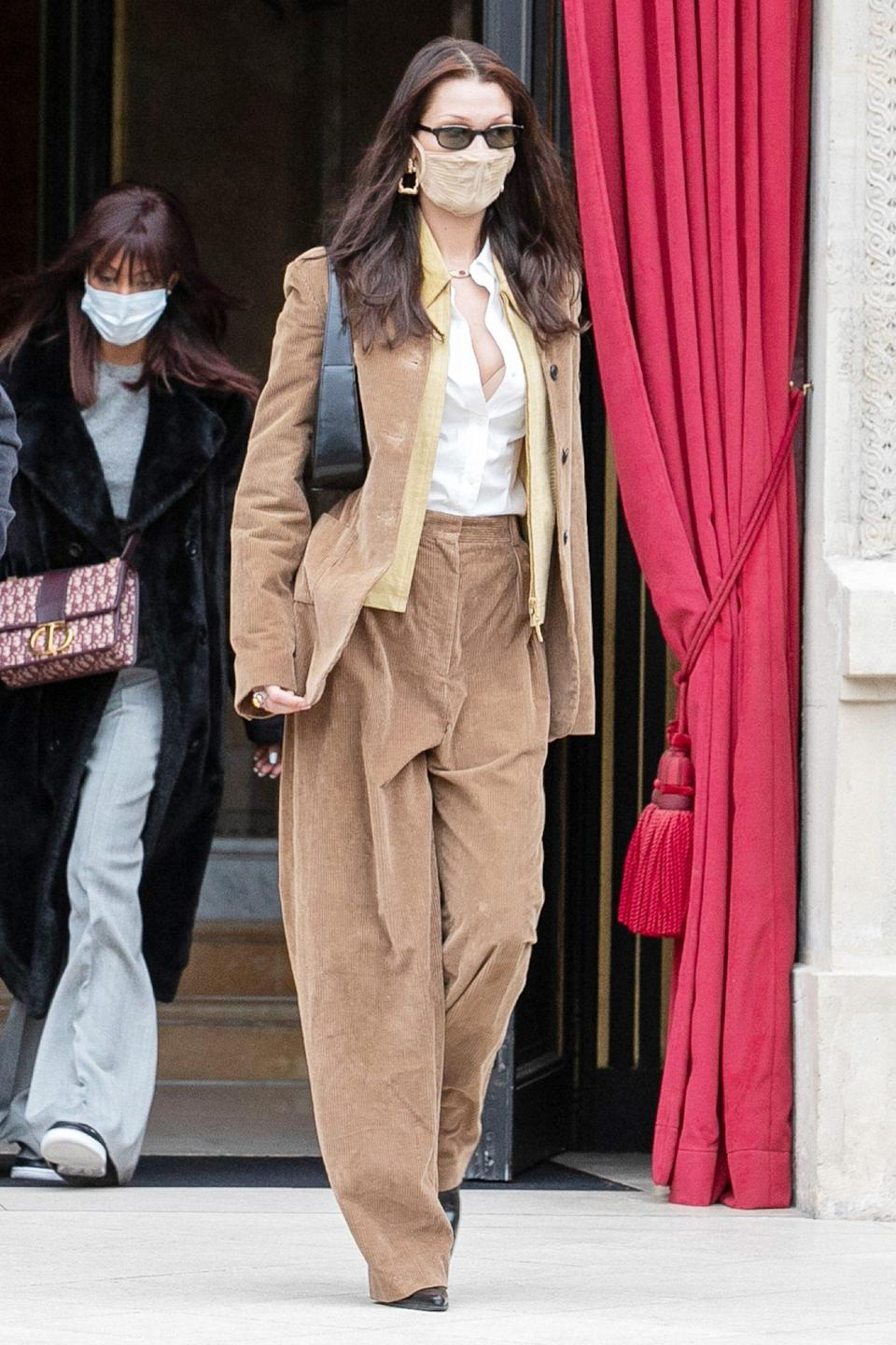 <p>Bella Hadid matches her outfit to her mask in Paris on Tuesday. </p>