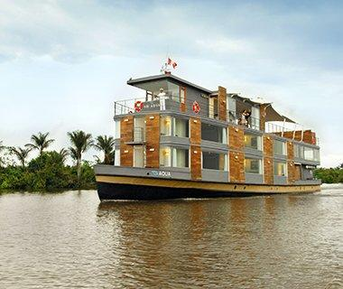 """<p><strong>Fleet: </strong>Four ships combine pampered luxury with nature on environmentally-conscious cruises through the Amazon, the Coral Triangle, and Cambodia and Vietnam.</p> <p><strong>What's Included:</strong> Meals, non-alcoholic beverages, select beer and wine, shore excursions, and more. </p> <p><strong>Sample Cruise:</strong> Three-night Amazon Discovery Cruise from $4,050 per person.</p> <p><a href=""""http://www.aquaexpeditions.com"""" rel=""""nofollow noopener"""" target=""""_blank"""" data-ylk=""""slk:aquaexpeditions.com"""" class=""""link rapid-noclick-resp"""">aquaexpeditions.com</a></p>"""