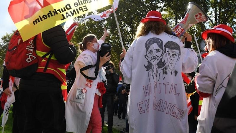 Health workers in France go on strike as coronavirus cases surge