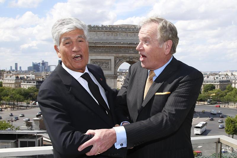 Maurice Levy, left, Chief Executive of French advertising group Publicis, and John Wren, head of Omnicom Group pose during a joint news conference in Paris, France, Sunday, July 28, 2013. Publicis and Omnicom have announced merger plans to create the world's biggest advertising group . (AP Photo/Francois Mori)