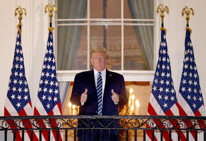 <p>U.S. President Donald Trump gives a thumbs up upon returning to the White House from Walter Reed National Military Medical Center on October 05, 2020 in Washington, DC</p> (Getty Images)