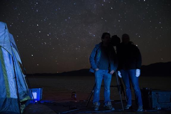 Steve Warwick, Northrop Grumman program manager for Starshade field testing, and Tiffany Glassman, astronomer and principal investigator for Starshade field testing, stand in the Starshade's shadow at the telescope station, demonstrating the te