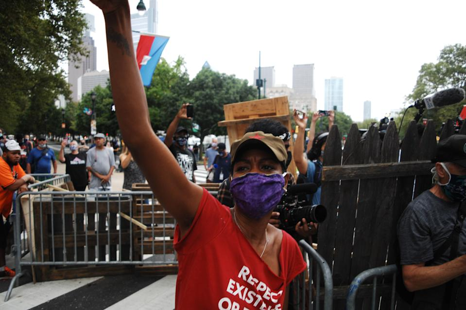 Housing activists and residents raise their fists in solidarity with each other and all unhoused people struggling each day to survive on the street or in an inadequate and ineffective shelter system that perpetuates homelessness and instability in Philadelphia, PA, on September 9, 2020. (Photo by Cory Clark/NurPhoto via Getty Images)