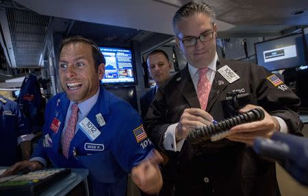 Specialist trader Michael Pistillo gives a price for a stock just after the opening bell on the floor of the New York Stock Exchange