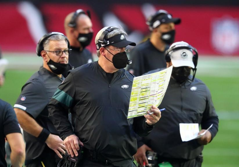 Doug Pederson stands on the sidelines with a play sheet in his hand