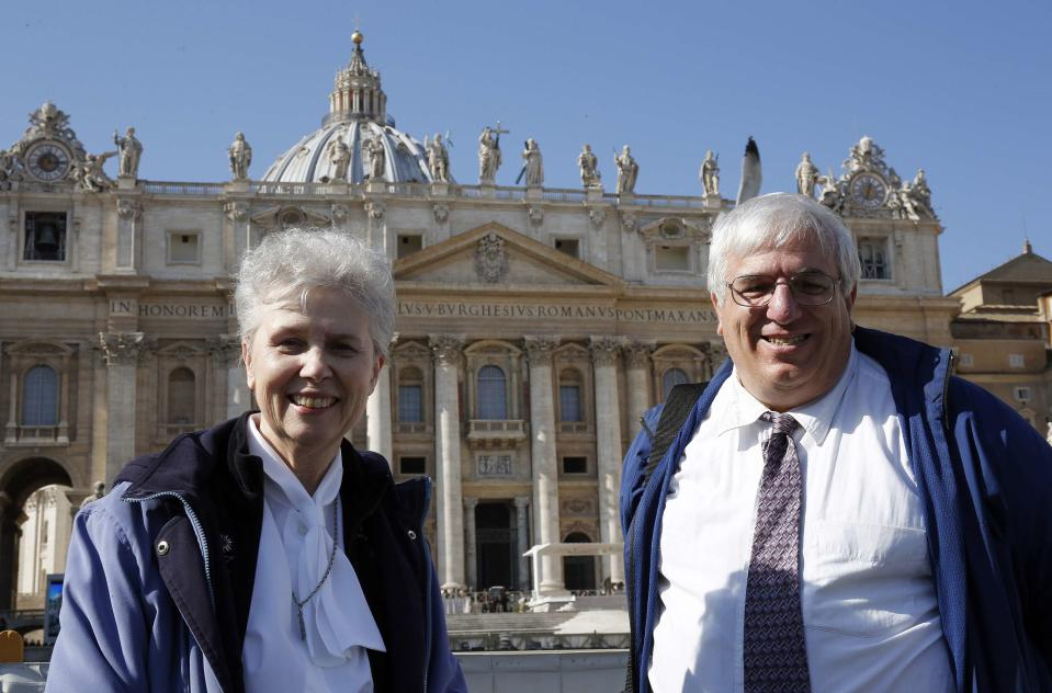 Sister Jeannine Gramick and Francis DeBernardo of New Ways Ministry, which ministers to homosexual Catholics and promotes gay rights, pose in front of St. Peter's Square after Pope Francis' weekly audience, February 18, 2015. The prominent American Catholic gay rights group was given VIP treatment for the first time at an audience with Pope Francis on Wednesday, a move members saw as a sign of change in the Roman Catholic Church. REUTERS/Giampiero Sposito (VATICAN - Tags: RELIGION)