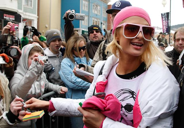 <p>Paris Hilton was in town to promote her new movie, <em>The Hottie & the Nottie</em>, wearing a shirt with her own face on it. Her movie didn't play at the festival, but all cameras — really old-school cameras! — were fixed on her anyway. (Photo: Frazer Harrison/Getty Images) </p>