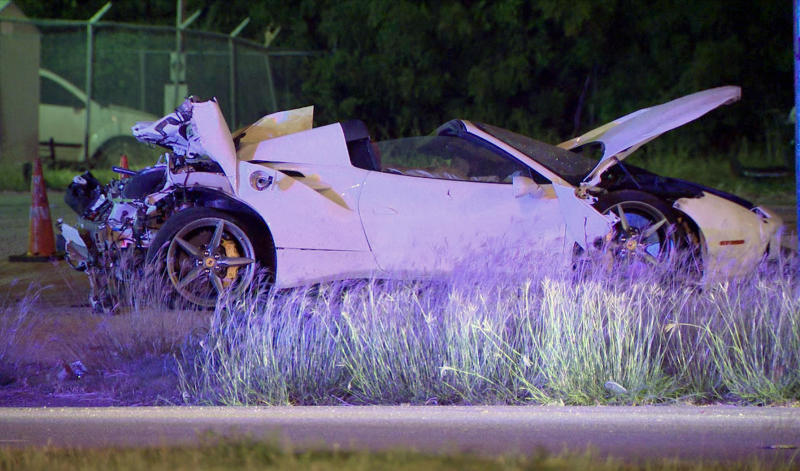 This photo taken from video provided by KDFW Fox 4 shows the scene after welterweight boxing champion Errol Spence crashed a speeding Ferrari in Dallas early Thursday, Oct. 10, 1019. (KDFW FOX4 via AP)