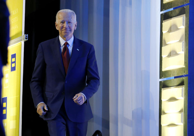 Democratic presidential candidate, former Vice President Joe Biden walks on stage during the Human Rights Campaign Columbus, Ohio Dinner at Ohio State University Saturday, June 1, 2019. (AP Photo/Paul Vernon)