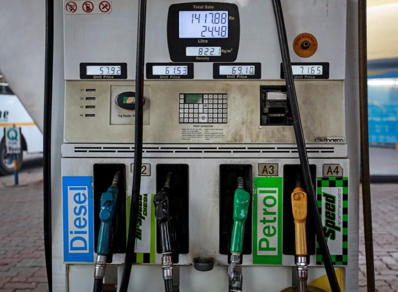 FILE PHOTO: Fuel pumps are seen at a Bharat Petroleum petrol station in Mumbai