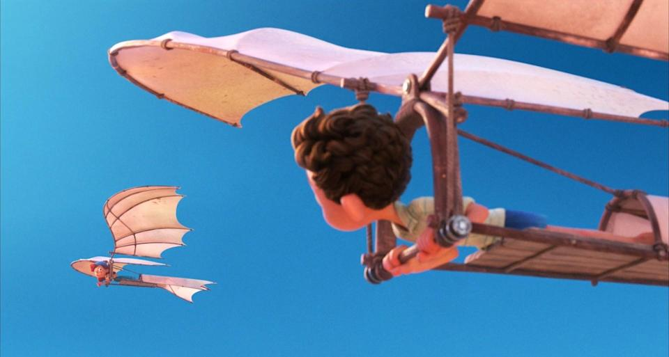 A girl and a boy flying in two contraptions