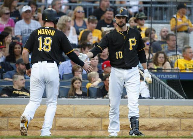 Pittsburgh's Colin Moran scores on a sacrifice fly in the Pirates 3-2 win against the Reds. (Getty Images)