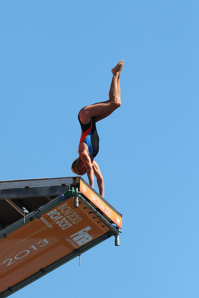 BARCELONA, SPAIN - JULY 30: Diana Tomilina of Ukraine competes during the Women's 20m High Diving on day eleven of the 15th FINA World Championships at Moll de la Fusta on July 30, 2013 in Barcelona, Spain. (Photo by Quinn Rooney/Getty Images)