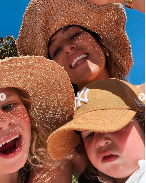 Phoebe Burgess and her children in the sun
