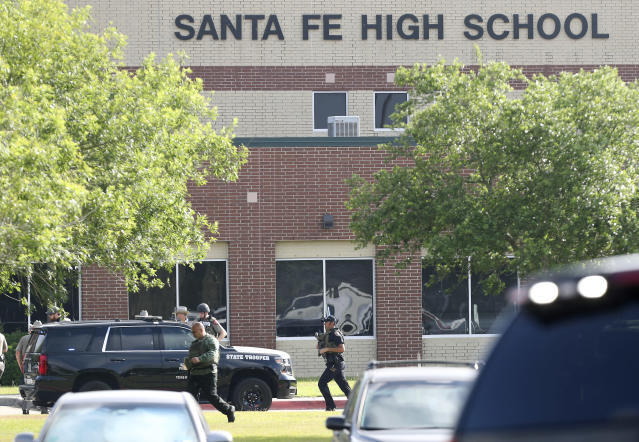 <p>Law enforcement officers respond to Santa Fe High School after an active shooter was reported on campus, Friday, May 18, 2018, in Santa Fe, Texas. (Photo: Steve Gonzales/Houston Chronicle via AP) </p>