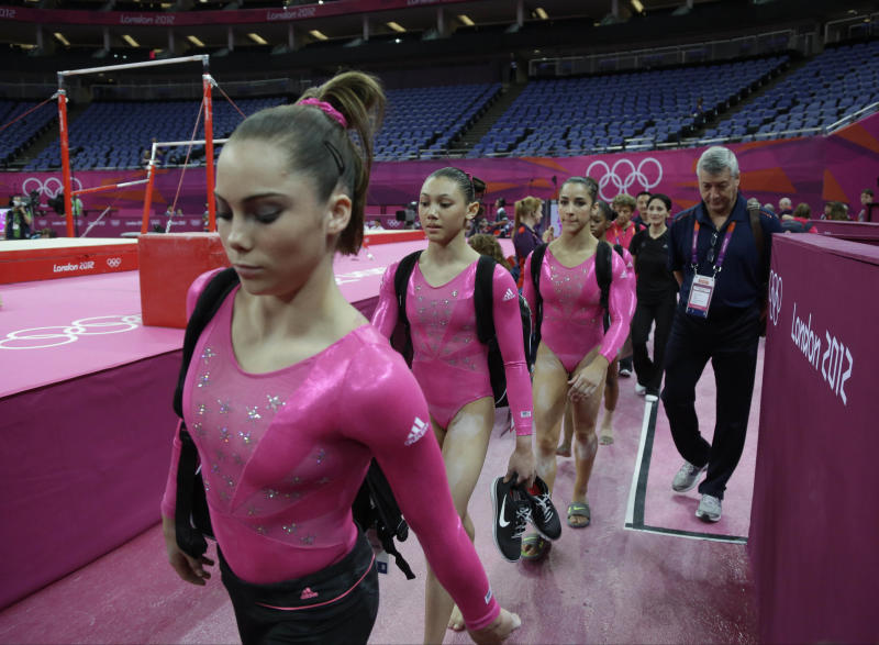 U.S. gymnasts walk to perform during training at the 2012 Summer Olympics, Thursday, July 26, 2012, in London. (AP Photo/Julie Jacobson)