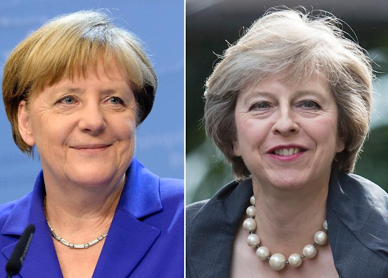 The parallels between new British Prime Minister Theresa May (R) and Germany's Angela Merkel are striking at first glance (AFP Photo/Thierry Charlier, Oli Scarff)