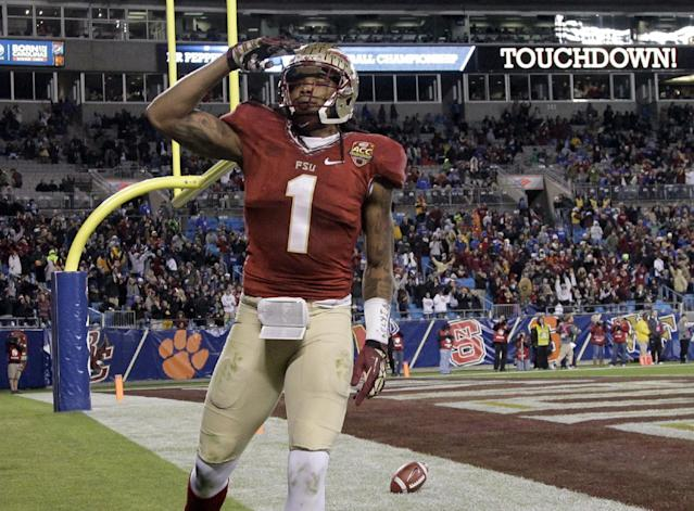 Florida State's Kelvin Benjamin (1) celebrates his touchdown catch against Duke in the second half of the Atlantic Coast Conference Championship NCAA football game in Charlotte, N.C., Saturday, Dec. 7, 2013. (AP Photo/Bob Leverone)