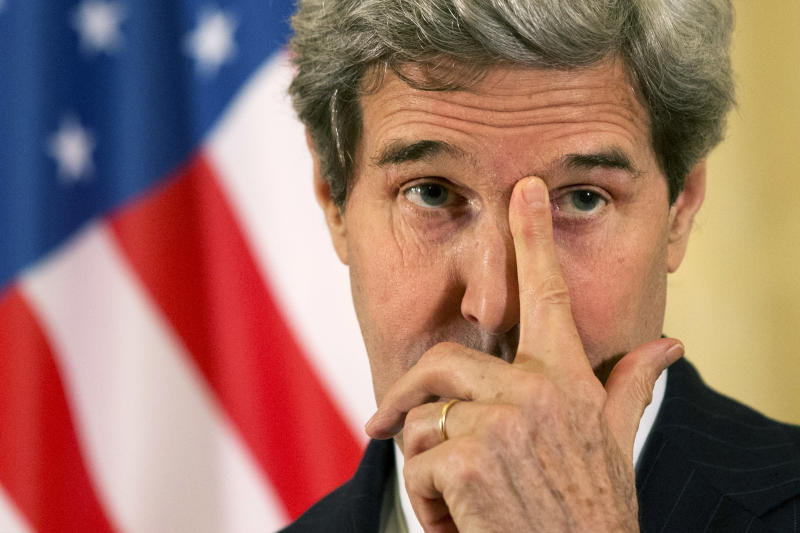 In this March 30, 2014, photo, U.S. Secretary of State John Kerry rubs his eye while listening to a question during a news conference at the U.S. Ambassador to France's residence in Paris, after he met with Russian Foreign Minister Sergey Lavrov about the situation in Ukraine. The current trip was to have been a five-day trip to Europe and Saudi Arabia, but with crisis on multiple fronts and Kerry's decision on how to proceed turned a routine trip abroad into a frenetic tour of high-stakes diplomacy marked by abrupt changes in plan that have come to define his 14-month tenure as secretary of state. (AP Photo/Jacquelyn Martin, Pool)
