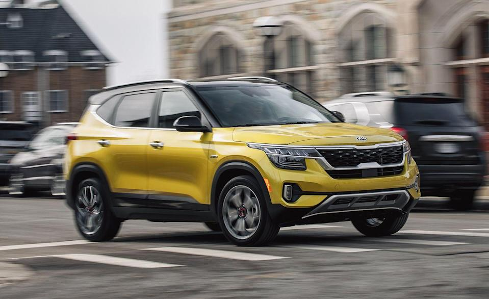 """<p>Maybe the best way to describe the <a href=""""https://www.caranddriver.com/kia/seltos"""" rel=""""nofollow noopener"""" target=""""_blank"""" data-ylk=""""slk:Kia Seltos"""" class=""""link rapid-noclick-resp"""">Kia Seltos</a> is to call it a bigger Kia Soul with available all-wheel drive. It matches the Soul for maximum carry-on stuffage and cargo volume, but it has a slight advantage in terms of rear cargo space when the rear seats are in use. There's also an adjustable two-tier cargo floor that turns the back of the Seltos into a small pit to prevent groceries and other cargo from rolling around. The Seltos is one of the best crossovers sold today, so even if you have to make a second trip to the store its not all bad news.</p><ul><li>Base price: $23,165</li><li>Carry-on capacity, rear seats folded: 20 suitcases</li><li>Cargo volume, rear seats folded: 62 cubic feet<br></li><li>Cargo volume, behind rearmost row of seats: 26 cubic feet<br></li></ul><p><a class=""""link rapid-noclick-resp"""" href=""""https://www.caranddriver.com/kia/seltos/specs"""" rel=""""nofollow noopener"""" target=""""_blank"""" data-ylk=""""slk:MORE SELTOS SPECS"""">MORE SELTOS SPECS</a></p>"""