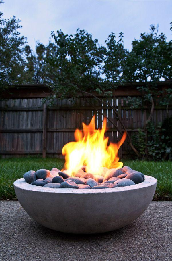 """<p>Sleek and super sturdy, this modern fire pit is also portable. Its best attribute? It can be made for less than $50.</p><p><strong>Get the tutorial at <a href=""""https://www.manmadediy.com/2618-how-to-make-a-diy-modern-concrete-fire-pit-from-scratch"""" rel=""""nofollow noopener"""" target=""""_blank"""" data-ylk=""""slk:ManMade"""" class=""""link rapid-noclick-resp"""">ManMade</a>.</strong></p><p><a class=""""link rapid-noclick-resp"""" href=""""https://go.redirectingat.com?id=74968X1596630&url=https%3A%2F%2Fwww.walmart.com%2Fip%2F3M-26060CP-P-G-Pro-Grade-No-Slip-Grip-Advanced-Sandpaper-9-X-11-Inches-60-Grit%2F545905180&sref=https%3A%2F%2Fwww.countryliving.com%2Fdiy-crafts%2Fg31966151%2Foutdoor-fireplace-ideas%2F"""" rel=""""nofollow noopener"""" target=""""_blank"""" data-ylk=""""slk:SHOP SANDPAPER"""">SHOP SANDPAPER</a></p>"""