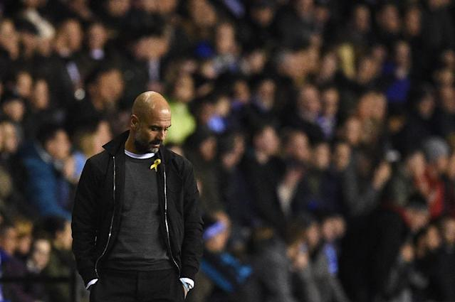 Manchester City manager Pep Guardiola will be eager to get his hands on a trophy, even if it would have been fourth on the list of his priorities when the campaign began (AFP Photo/Oli SCARFF )
