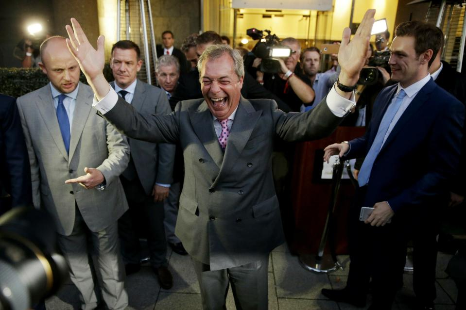 """FILE - In this Friday, June 24, 2016 file photo Nigel Farage, the leader of the UK Independence Party, celebrates and poses for photographers as he leaves a """"Leave.EU"""" organisation party for the British European Union membership referendum in London. (AP Photo/Matt Dunham, File)"""